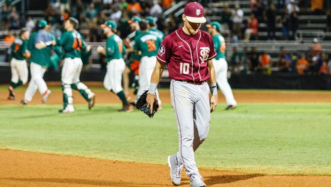 Florida State shortstop Taylor Walls (10) walks off the field during the Seminoles 5-4 loss to Miami in extra innings on Saturday night at Alex Rodriguez Park.