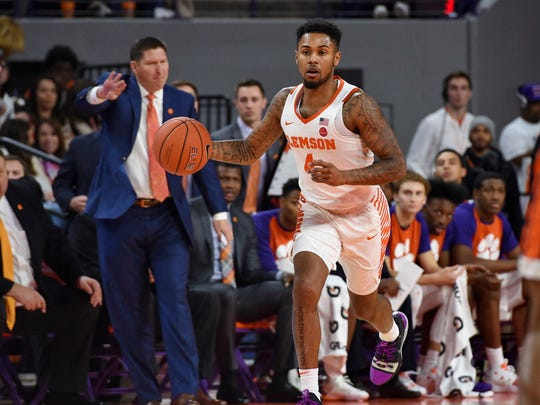 Clemson's Shelton Mitchell brings the ball up the court