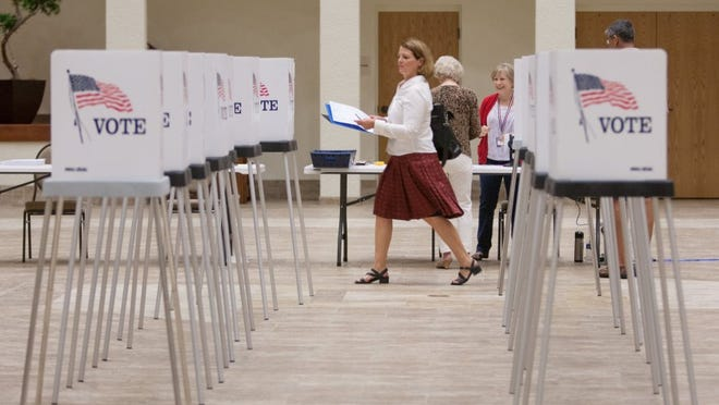 Cary Zahaby makes her way to a booth to place her vote in a relatively empty polling station at St. Leo Catholic Church's Parish Life Center on Election Day in Bonita Springs, FL on Tuesday, March 15, 2016.