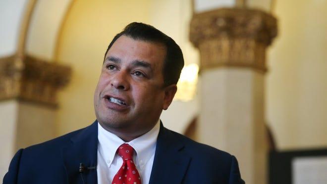 Tim R. Vasquez speaks in to the media in 2016.