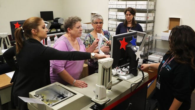 Staff members at the Shasta County Clerk's Office on Tuesday,  Nov. 22, 2016, count ballots that had been incorrectly filled out or otherwise caused errors at the office. Staff members spent the previous two weeks counting the final 26,000 ballots from the Nov. 8 General Election.