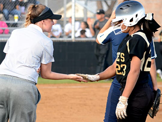 Abilene High softball assistant Kinzee Willis gives