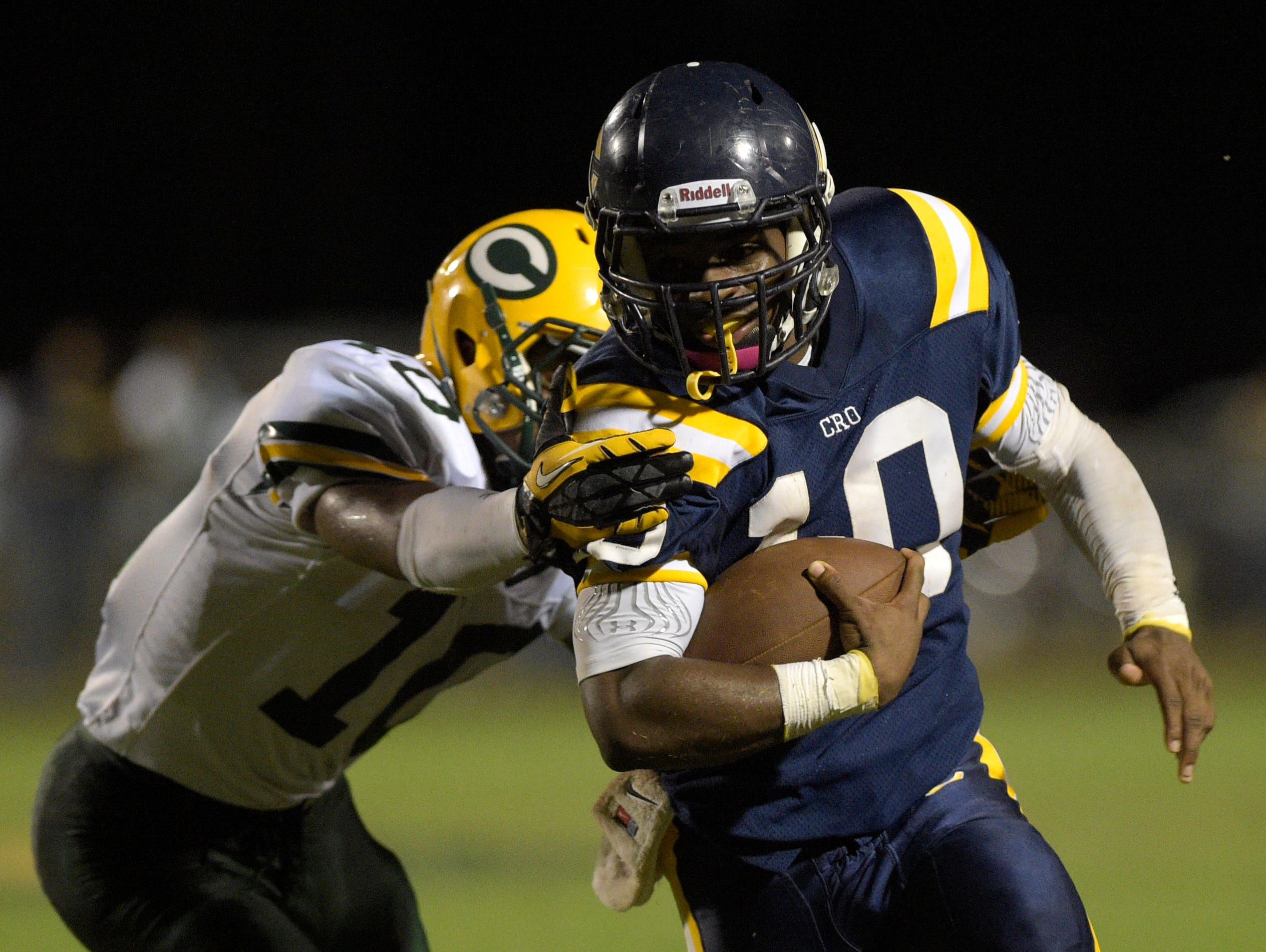 Carencro running back Tyriek Campbell (10), right, tries to shed the tackle of Cecilia's Keldrick Zeno (10) during the Kiwanis Jamboree at Carencro High on Friday.