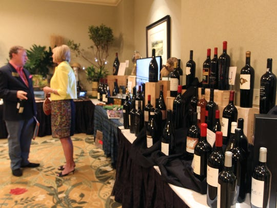 A variety of wines are diplayed in one of the lot rooms during the Naples Winter Wine Festival on Saturday.