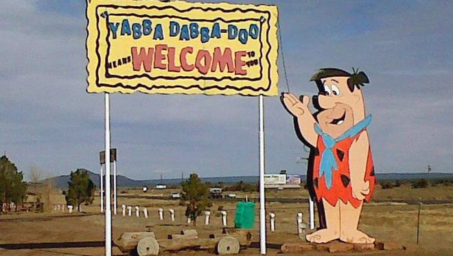 The welcome sign at the Flintstone's Bedrock City in Williams.