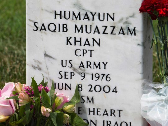 "The grave marker for US Army Captain Humayun Saqib Muazzam Khan,who was killed in Iraq in 2004 in a roadside explosion, is seen August 1, 2016, in Section 60 of Arlington National Cemetery in Arlington, Virginia. The father of a slain Muslim American soldier assailed Donald Trump as a ""black soul"" July 31 in an impassioned exchange with the Republican presidential candidate over the qualities required in a US leader. Khizr Khan electrified the Democratic convention last week with a tribute to his fallen son that ended with a steely rebuke that Trump had ""sacrificed nothing"" for his country."