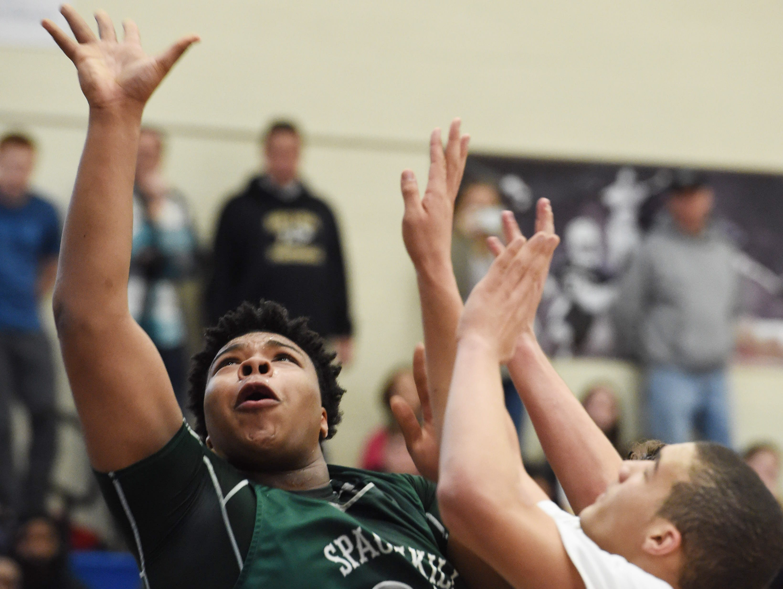Spackenkill's Kyiev Bennermon, left, goes for a layup during Saturday's Class B regional final game against Center Moriches at Suffolk County Community College in Selden.