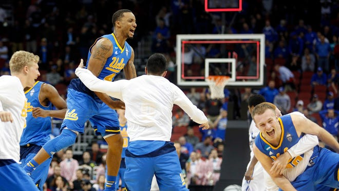 UCLA celebrates after taking down SMU to advance in the NCAA tournament.  March 19, 2015