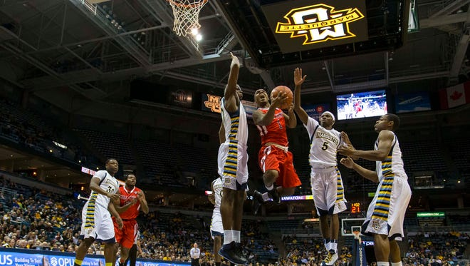Dec 17, 2013; Milwaukee, WI, USA; Ball State Cardinals guard Zavier Turner (1) drives for the basket as Marquette Golden Eagles center Chris Otule (42) defends during the second half at BMO Harris Bradley Center. Mandatory Credit: Jeff Hanisch-USA TODAY Sports