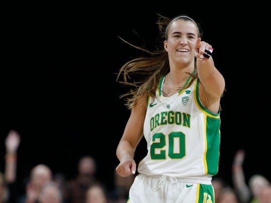 Oregon's Sabrina Ionescu (20) reacts after her team scored against Stanford during the second half of an NCAA college basketball game in the final of the Pac-12 women's tournament Sunday, March 8, 2020, in Las Vegas. (AP Photo/John Locher)