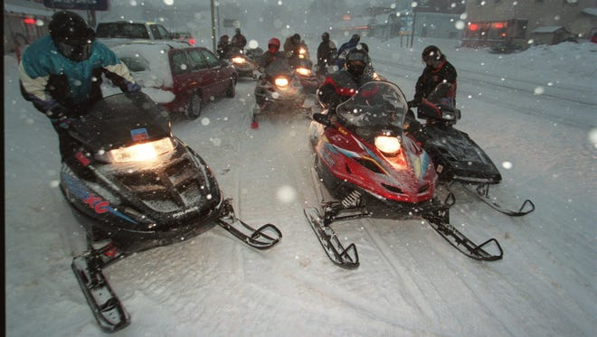 Snowmobilers near Lake Superior.
