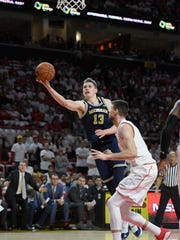 Michigan forward Moritz Wagner goes to the basket against