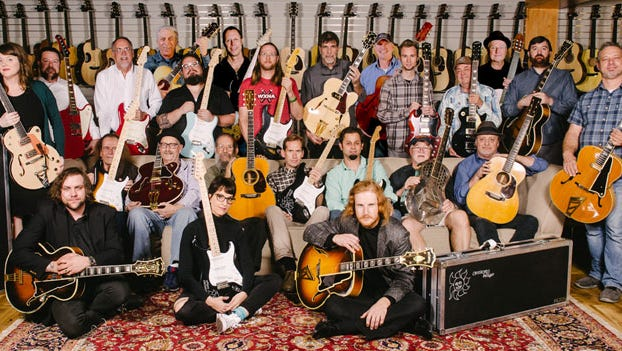 The Gruhn Guitars staff with instruments from Eric Clapton's personal collection