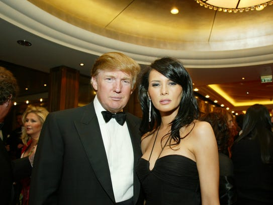 Donald and Melania Trump pose in their formal wear