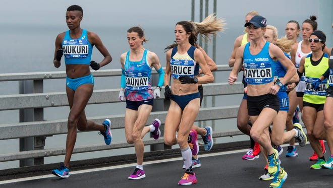 Nov 5, 2017;Stephanie Bruce (USA, third from left) competes in the New York City marathon. Bruce finished 10th. She will run in the Rock 'n' Roll Arizona 1/2 Marathon.