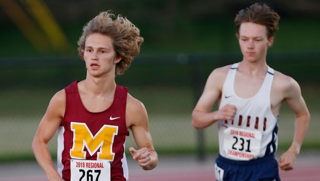 Will Persin of McCutcheon and Will White of Harrison in the 3200 meter run during the boys track and field regional Thursday, May 24, 2018, at Lafayette Jeff. Persin won the event with a time of 9:10 and will advance to the state finals. White finished in fourth place with a time of 9:19.33.