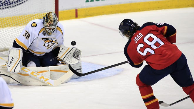 Predators goalie Carter Hutton (30) makes a save on a shot by Panthers right wing Jaromir Jagr (68) in the first period Saturday.