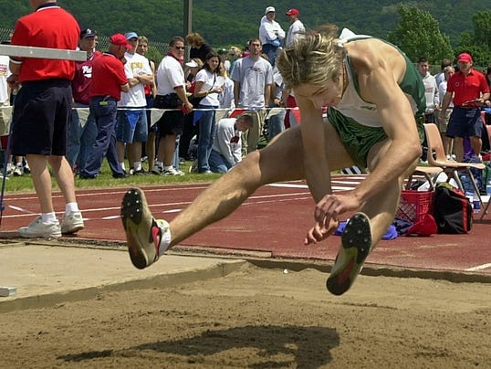 Rick Bellford competes in long jump at WIAA state meet