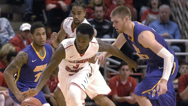 Illinois State University's Daishon Knight (3) takes control of a loose ball between Northern Iowa's Deon Mitchell (1) and Seth Tuttle (10) during an NCAA basketball game in Normal, Ill., Sunday, Jan. 25, 2015.