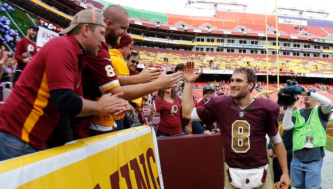 Washington Redskins quarterback Kirk Cousins (8) celebrates with family members in the stands after the Redksins' gme against the Tampa Bay Buccaneers at FedEx Field. The Redskins won 31-30.