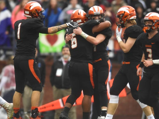Greenback celebrates a touchdown during the first half of the Class 1A state championship game at Tucker Stadium in Cookeville, Tenn., Thursday, Nov. 30, 2017.