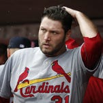 St. Louis Cardinals starting pitcher Lance Lynn walks back to the dugout at the end of the fifth inning after giving up a three-run home run to the Cincinnati Reds' Tucker Barnhart Saturday in Cincinnati. The Reds won 5-1.
