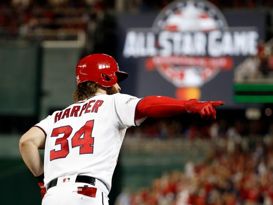 Washington Nationals' Bryce Harper runs the bases for his two-run home run in the eighth inning in Game 2 of baseball's National League Division Series against the Chicago Cubs, at Nationals Park, Saturday, Oct. 7, 2017, in Washington. (AP Photo/Alex Brandon)