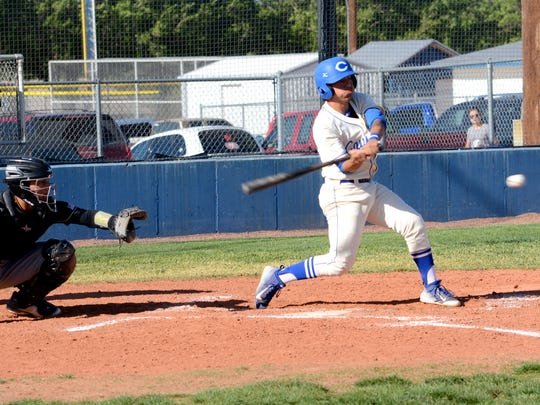 Carlsbad's Seth Olguin makes contact at the plate in game one Friday against Hobbs.