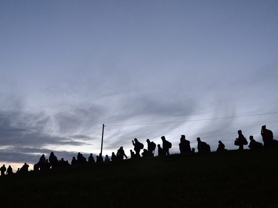Syrian and other migrants after crossing the border between Austria and Germany in October.