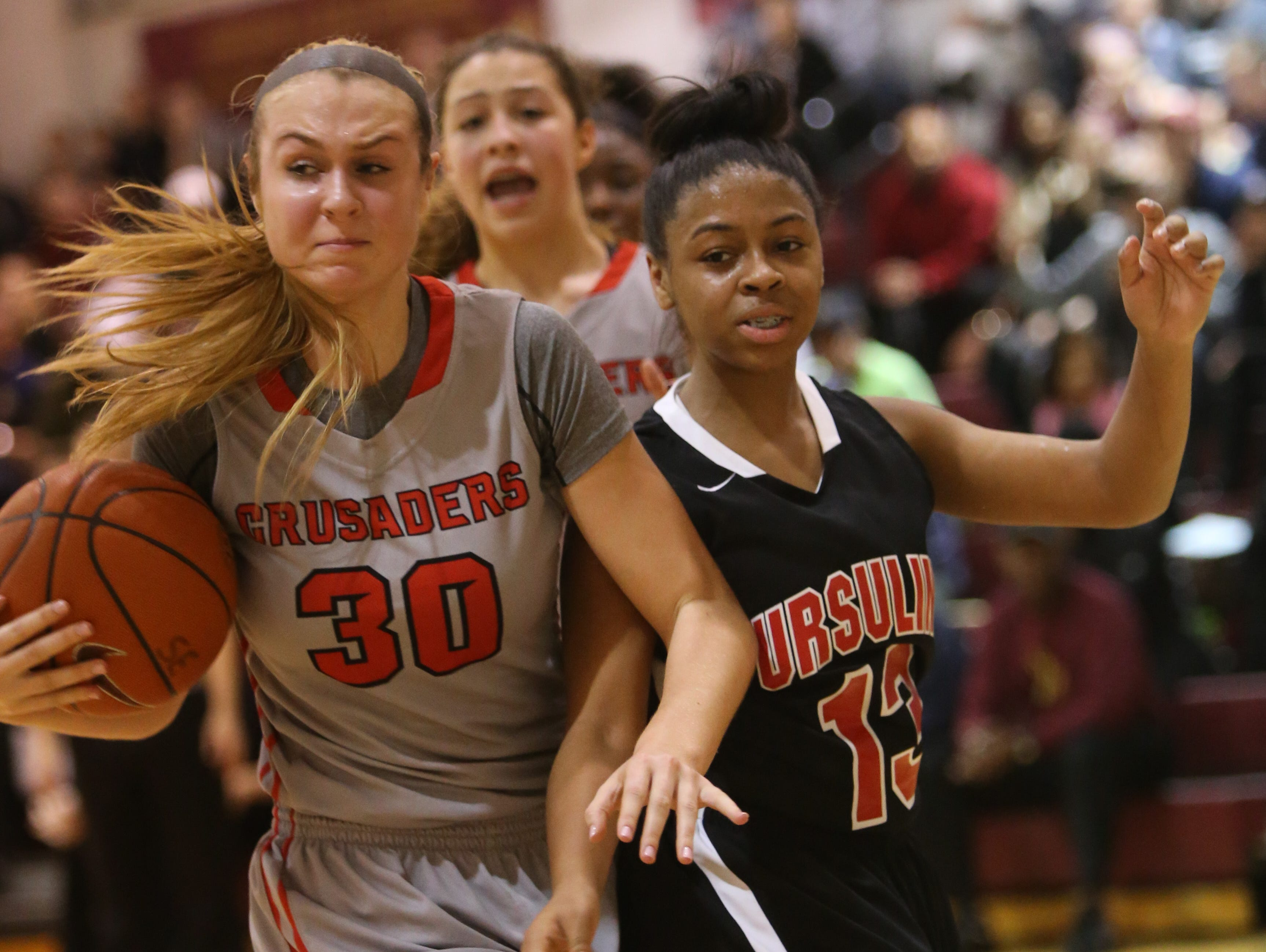 Long Island Lutheran forward Aislinn Flynn keeps the ball from Ursuline guard Sabriya Harris in the third quarter,. Ursuline falls to Long Island Lutheran 52-55 in the semifinals of the Saint Francis Healthcare Cup of the Diamond State Classic at St. Elizabeth High School Tuesday.