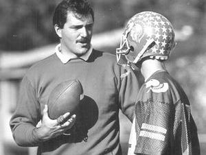 North College Hill football coach Bruce Baarendse talks with wide receiver Rick Kates in 1987. Baarendse passed away on Thursday, Dec. 3, 2015.