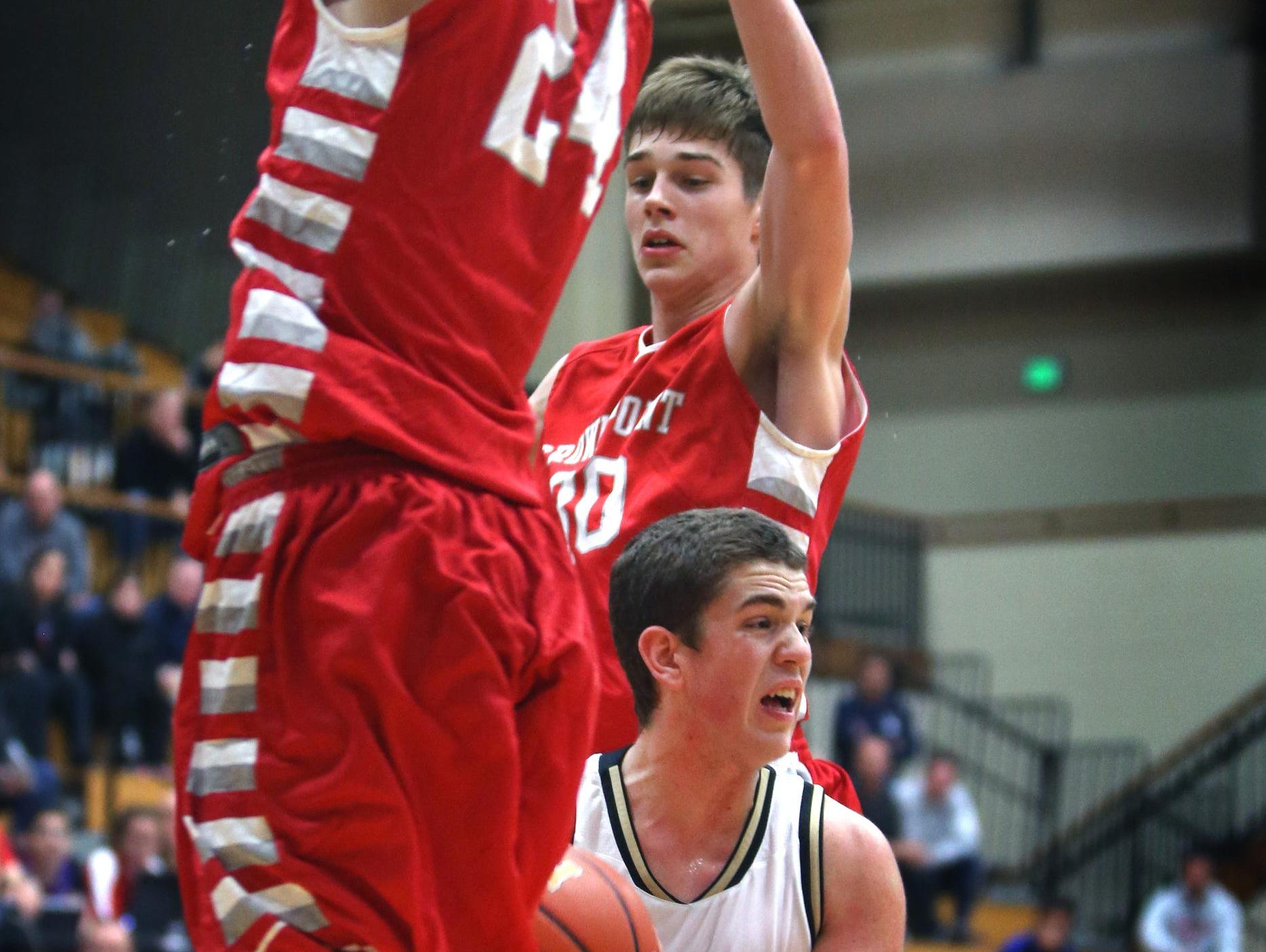 In this Dec. 30, 2014 file photo, Crown Point's Grant Gelon (right) and teammate Noah Morales defend against Noblesville's Sean Wilson.