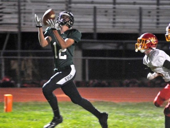 Parker Bradley make a touchdown reception to give Fisher Catholic a 12-0 lead. Fisher Catholic took on Worthington Christian Saturday night at Fulton Field. David Stith/Eagle-Gazette