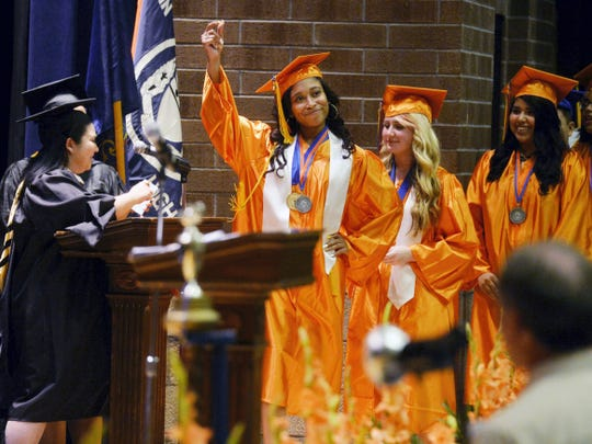 Q'ajaniyah Miller celebrates during her graduation from William Penn High School in June 2014.