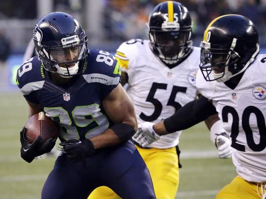 Ted S. Warren/AP Seahawks wide receiver Doug Baldwin runs for a touchdown against Steelers defenders Will Allen (20) and Arthur Moats on Sunday in Seattle. Seattle Seahawks' Doug Baldwin (89) heads in to score a touchdown as Pittsburgh Steelers Will Allen (20) and Arthur Moats (55) defend in the second half of an NFL football game, Sunday, Nov. 29, 2015, in Seattle. (AP Photo/Ted S. Warren)