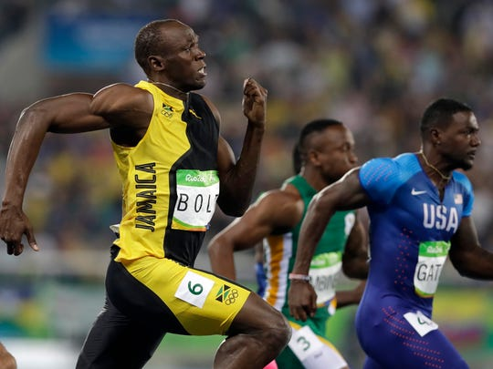 Jamaica's Usain Bolt, left, and United States' Justin