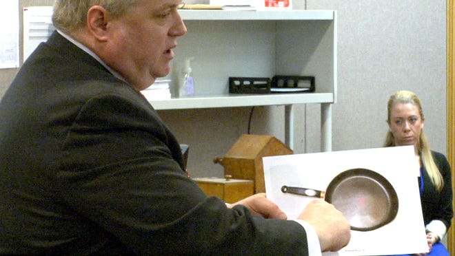 Patrick Allen's defense attorney John Allen holds a photograph of the frying pan that was alledgedly used in the murder of Kimberly Allen. Closing arguments were delivered in Judge John T. Mullaney's courtroom in Freehold, Tuesday, December 2, 2014.