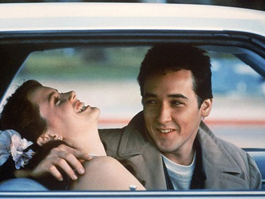 """Ione Skye and John Cusack get a little closer in a scene from """"Say Anything ... """""""
