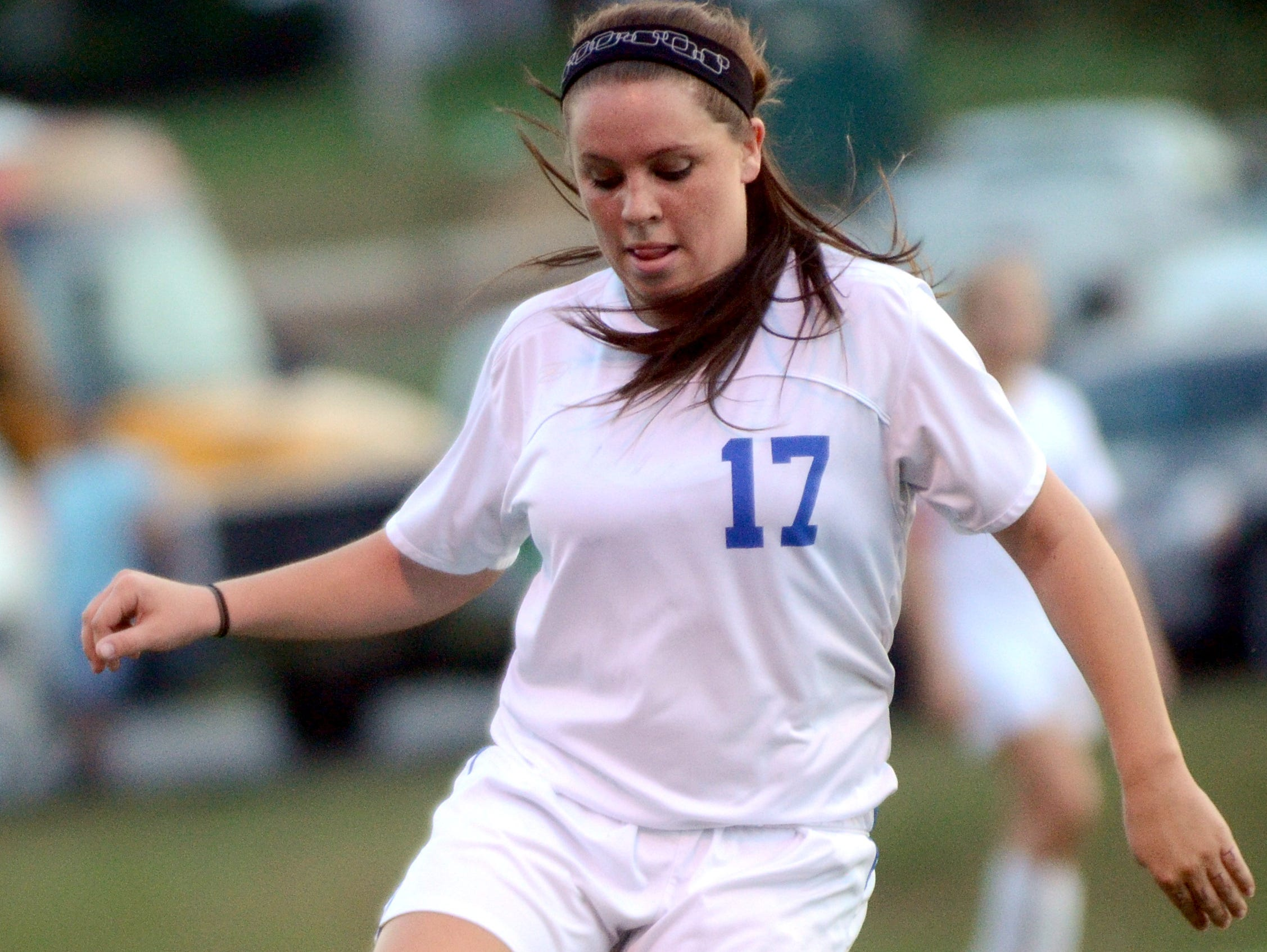 White House High senior midfielder Sidney West gains possession during first-half action on Monday evening.