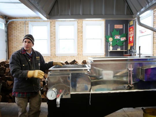 Jason Neumann, public programs manager at the Cincinnati Nature Center, talks about the center's evaporator and how it is used to make maple syrup.