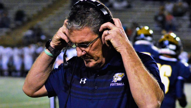 Stephenville coach Greg Winder speaks to assistand coaches on the headset during a 63-34 win over Pampa in a Class 4A DI area round game in Wichita Falls on Fri., Nov. 25, 2017.