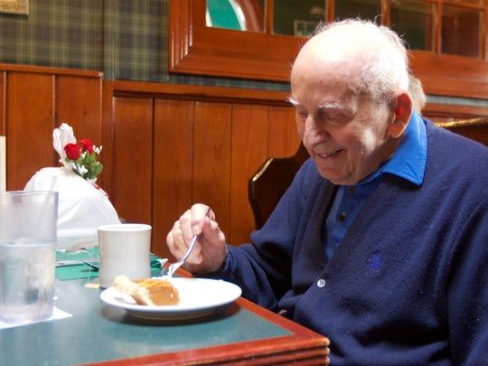 Irving Bauman, 99, said he served as an aerial photo