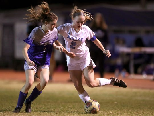 Maclay's Anna Lewis battles for the ball against Rocky Bayou Christian's Anna Colquitt in the Marauder's 2-1 District 1-1A championship win on Friday, Jan. 26, 2018.