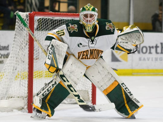 Vermont goalie Stefanos Lekkas (40) keeps an eye on the puck during the men's hockey game between the Northeastern Huskies and the Vermont Catamounts at Gutterson Fieldhouse on Friday night February 16, 2018 in Burlington.
