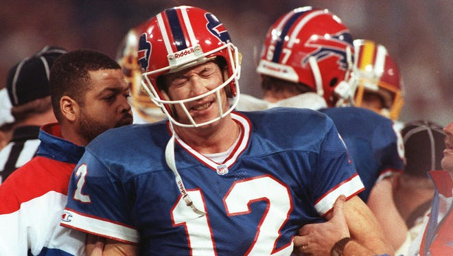 Buffalo Bills quarterback Jim Kelly grimaces during the Bills 37-24 in Super Bowl XXVI against the Washington Redskins in Minneapolis on Jan. 27, 1992.