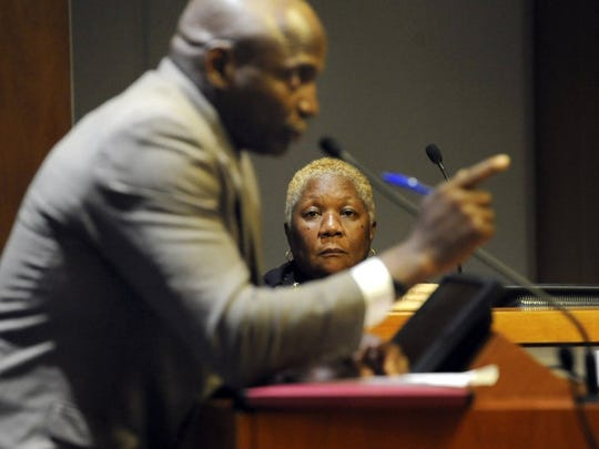 Fort Pierce Police Chief Diane Hobley-Burney listens as Mark Hadden (foreground), of Fort Pierce, speaks to the Fort Pierce City Commission during a special meeting on May 4 at Fort Pierce City Hall regarding the fatal officer-involved shooting of Demarcus Semer. (FILE PHOTO)
