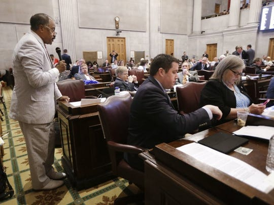 Rep. John DeBerry, D-Memphis, left, speaks during the debate to override Gov. Bill Haslam's veto of a bill seeking to make the Bible the state's official book, Wednesday, April 20, 2016, in Nashville, Tenn. The House voted not to override the veto.