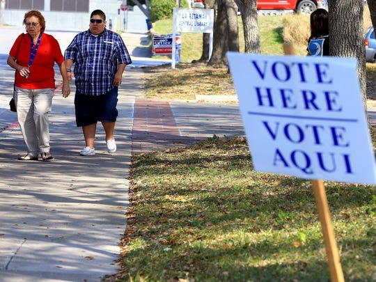 People exit La Retama Central Library after casting their vote Tuesday, March 1, 2016, in Corpus Christi.