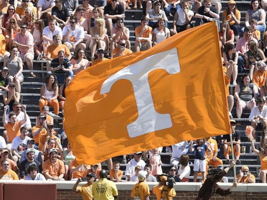 Amy Smotherman Burgess/News Sentinel The Power T flag makes an appearance during the 2014 Orange and White game.