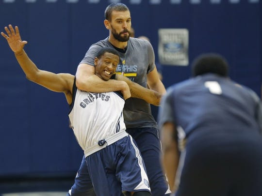 Marc Gasol ties up Troy Williams during a drill during the first day of Memphis Grizzlies training camp in September.